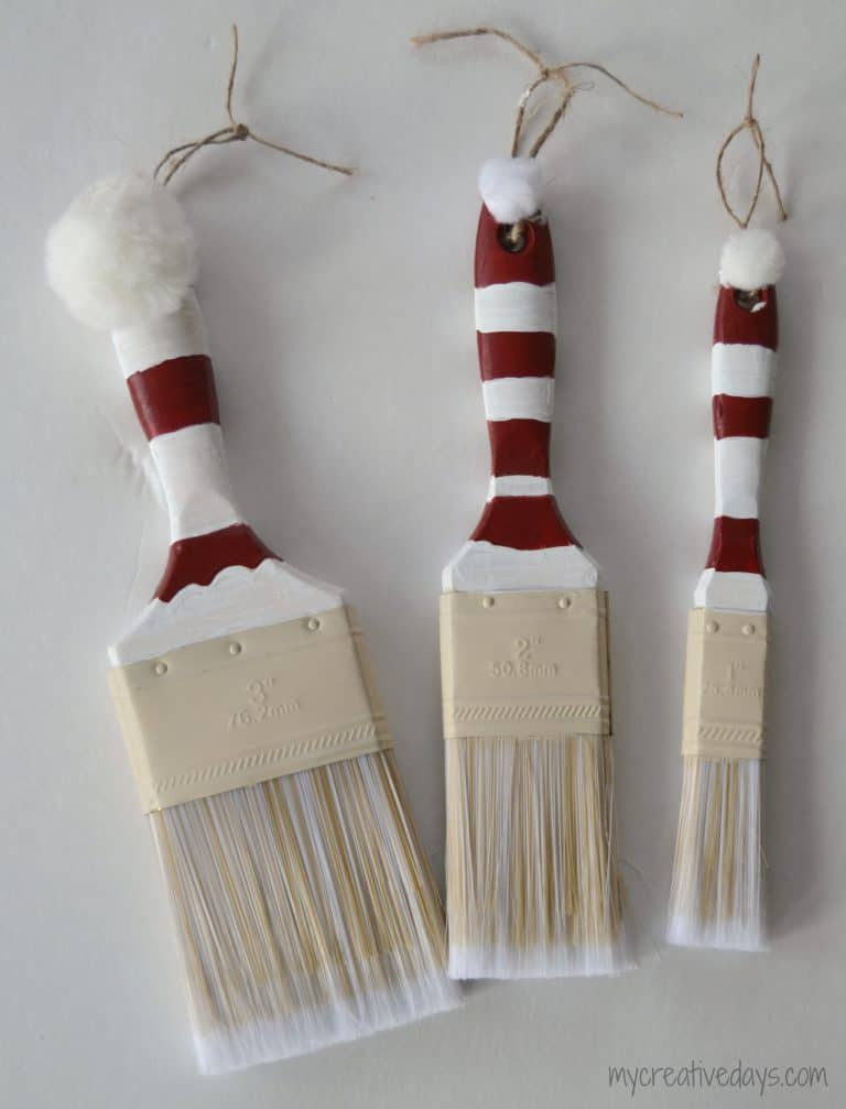 Looking for a fun homemade Christmas ornament idea? These Paint Brush Santas are easy and so cute.