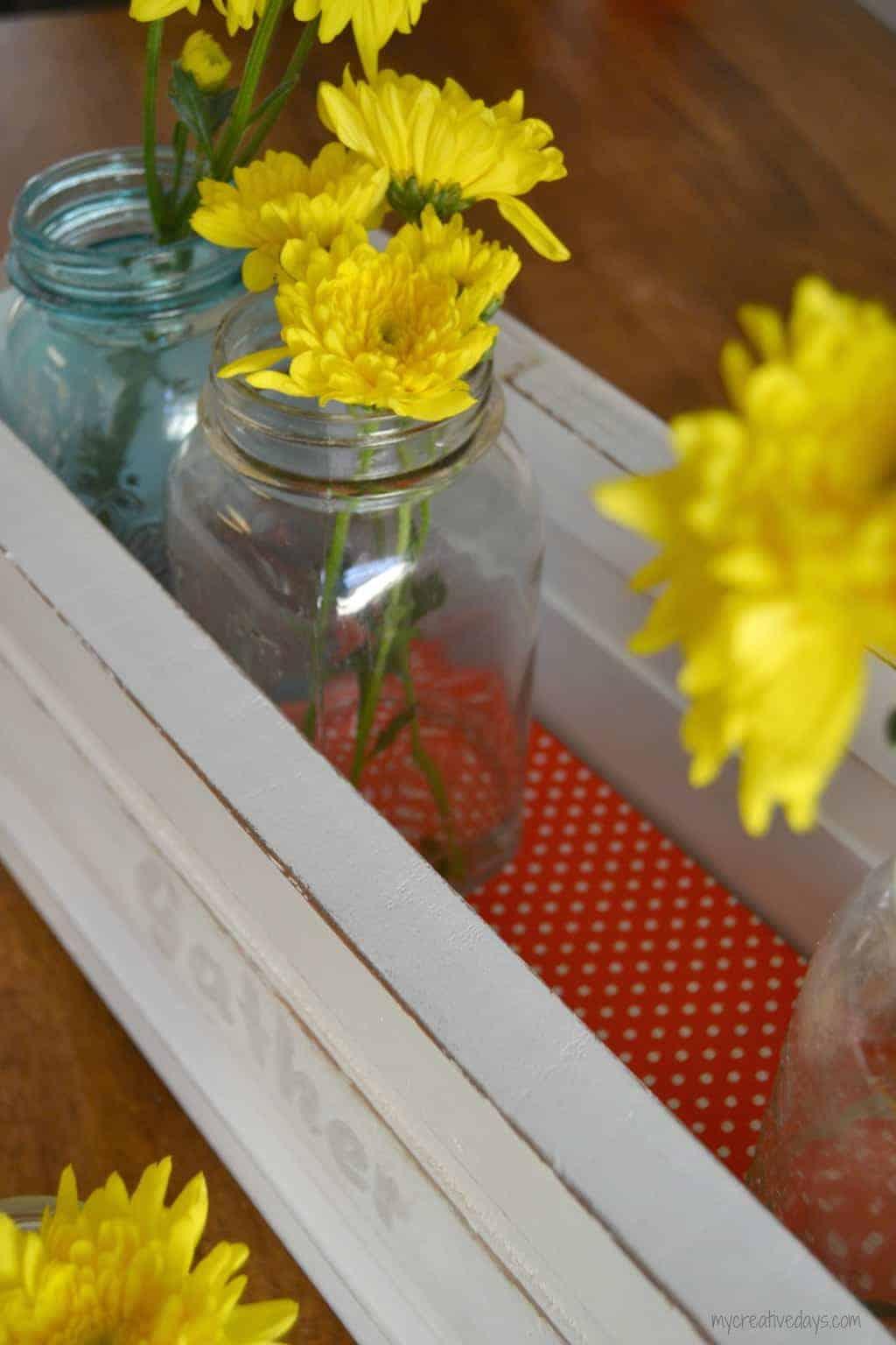 A DIY Mason jar caddy that will display your favorite jars