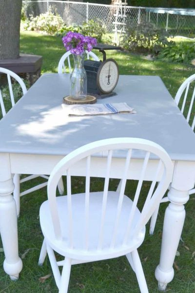 Are you looking for a farmhouse kitchen table and chairs? Search local yard sales and customize a set like we did with this one.