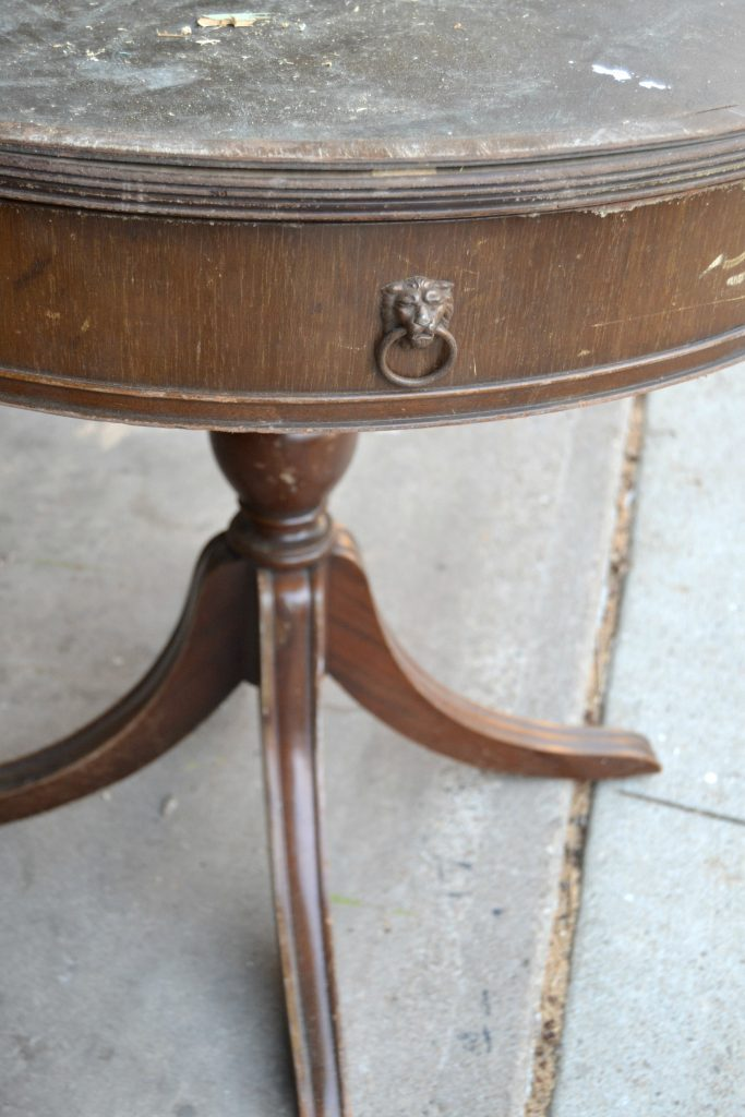 """If you are on the market <strong>Harriet Bee</strong> for a round end table in your space, save your money and DIY a painted round end table. Click over and see how easy it is to do!"""" width=""""683″ height=""""1024″ srcset=""""https://mycreativedays.porch.com/wp-content/uploads/2016/04/Easy-Round-End-Table-2.jpg 683w, https://mycreativedays.porch.com/wp-content/uploads/2016/04/Easy-Round-End-Table-2-600×900.jpg 600w, https://mycreativedays.porch.com/wp-content/uploads/2016/04/Easy-Round-End-Table-2-200×300.jpg 200w, https://mycreativedays.porch.com/wp-content/uploads/2016/04/Easy-Round-End-Table-2-400×600.jpg 400w"""" sizes=""""(max-width: 683px) 100vw, 683px"""" /></p> <p>The round end table had a faux leather top that was coming off. There was also a piece missing from the rim around the table.</p> <p style="""