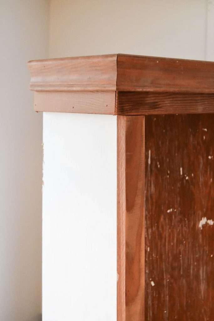 Bookshelf Makeover - Looking to make over a plain bookshelf to make it look more custom? This DIY Bookshelf Makeover was easy to do with trim pieces and wrapping paper.