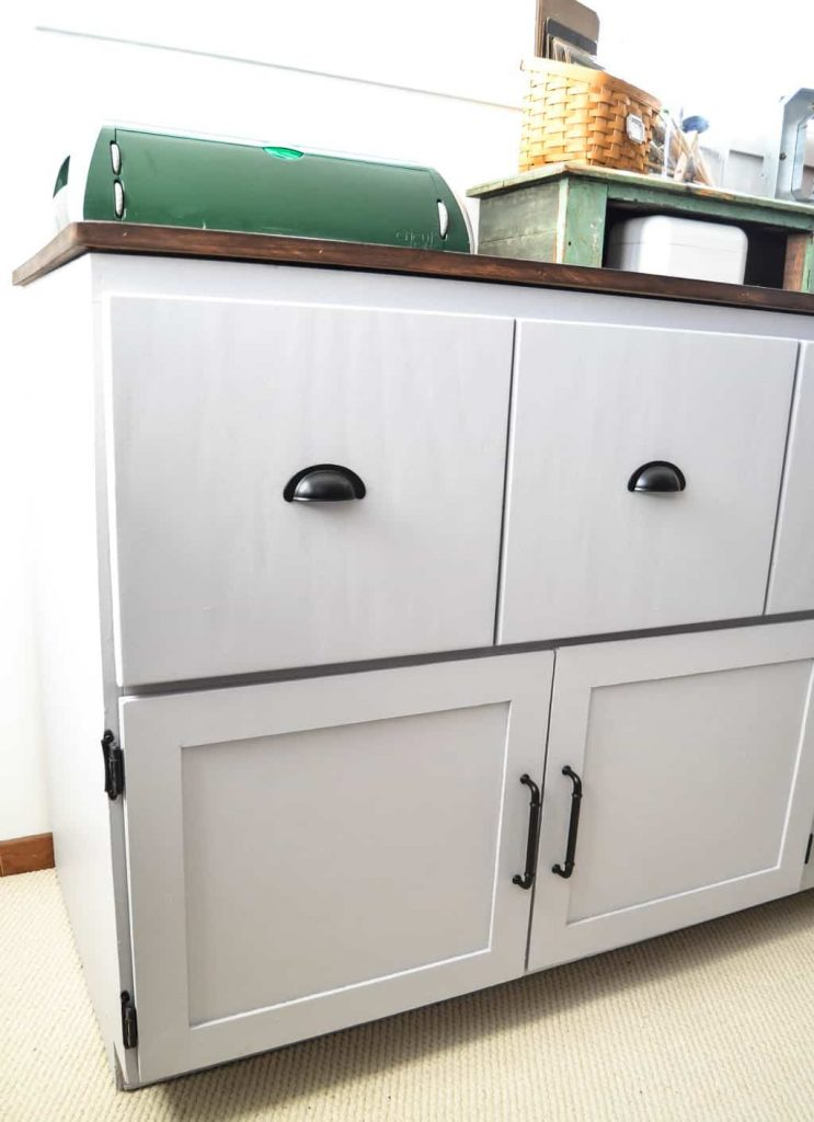 Office Cabinet Makeover - Looking for ways to make over furniture for your home office? This Office Cabinet Makeover takes a run down piece and makes it pretty again and perfect for an office.