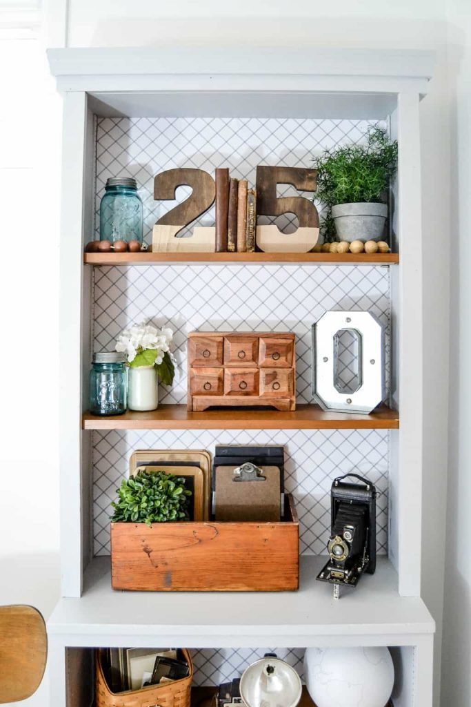 If you are looking for wall bookshelves for your home, click over to see how we took plain wall bookshelves and make them look custom in a few short steps.