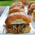Coca-Cola™ BBQ Pulled Pork Sliders - Looking for an easy meal to make during your summer back yard party? These Coca-Cola™ BBQ Pulled Pork Sliders are easy to make and a definite crowd pleaser.