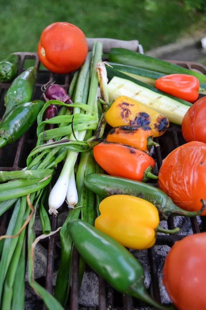 Roasted Garden Salsa Recipe- This easy Roasted Garden Salsa Recipe takes advantage of vegetables from your garden. Make it at the table during your alfresco meal!
