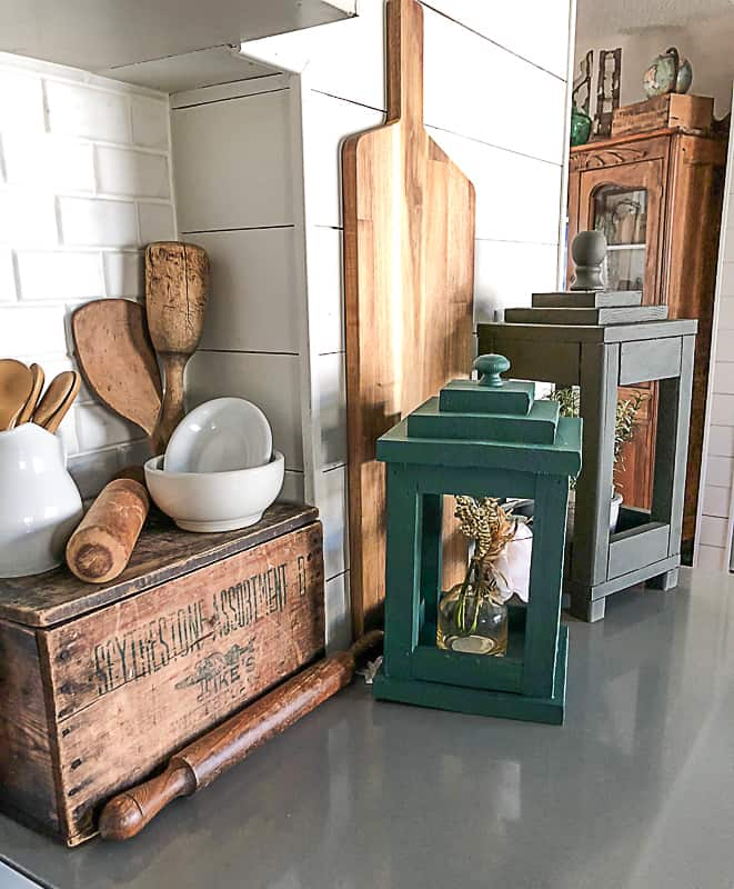 Lanterns can be used for all kinds of things in home decor. Click over to see how you make DIY lanterns from scrap wood.