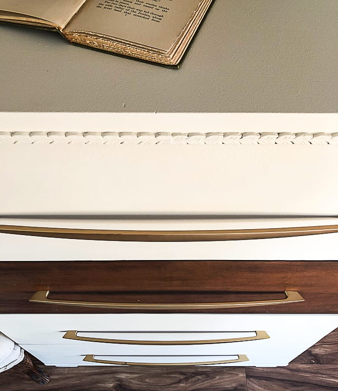 If you love the look of a Mid-Century Modern Dresser, click over to find the easy way to DIY one that will save your budget!