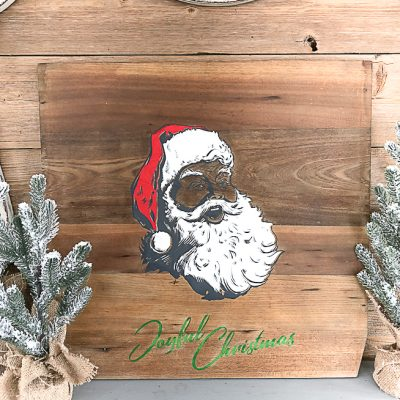 I love to add wood signs to our home but don't want to pay a high price for them. Click over to see how I made DIY Christmas wood signs easily and inexpensively.