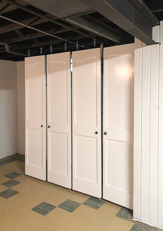 Hanging doors in the flip house was an easy and inexpensive solution to hide the mechanicals while still leaving them accessible if needed.
