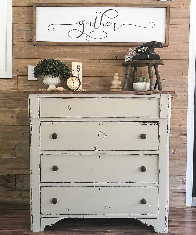 Painting furniture can be intimidating. This post will wall you through the easy steps and teach you how to paint a wooden dresser.