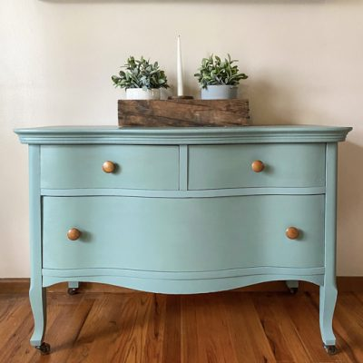 This Bird's Eye Maple Dresser Makeover tutorial shows you how to brings life to an old piece in a big way with some cleaning, a fun paint color and wax!