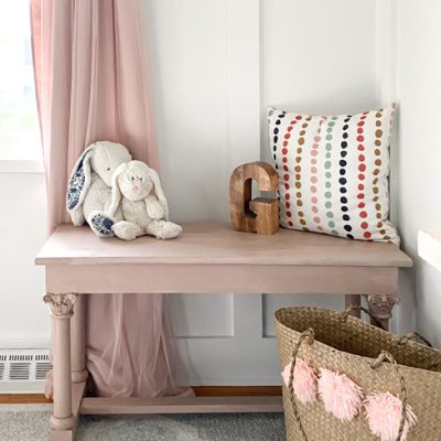 An old piano bench that called for a Pretty in Pink Bench Makeover to highlight the details on the legs and make it beautiful again.