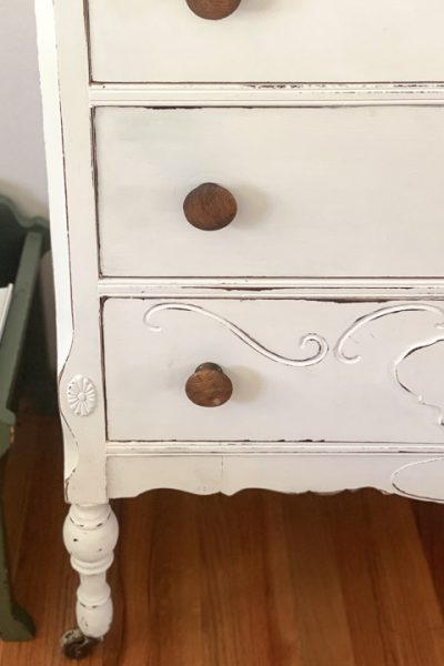 This Dresser Makeover With White Paint & BOSS was an easy transformation that made this outdated dresser pretty again in just a few steps.