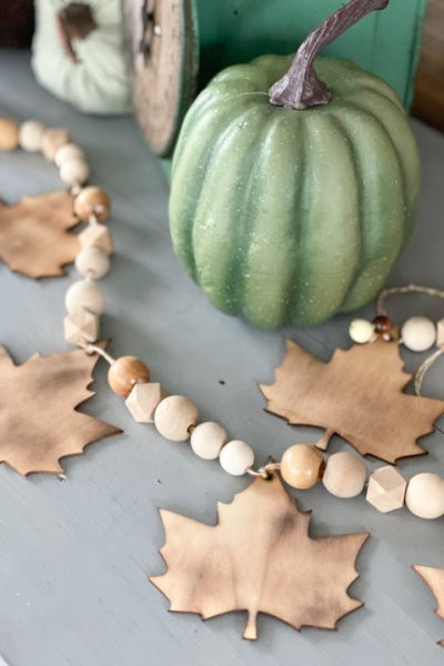 This DIY Dollar Store Fall Garland Craft could not be any easier and the outcome looks like you spent a lot of time and/or money on it.
