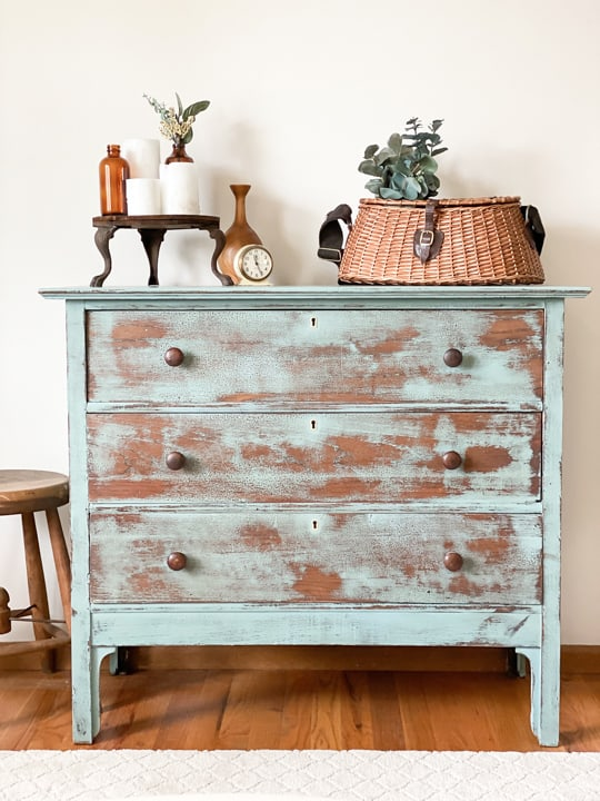 This Vintage Blue Dresser Makeover was done with some chalk mineral paint, a sander and a product to deepen the blue color.