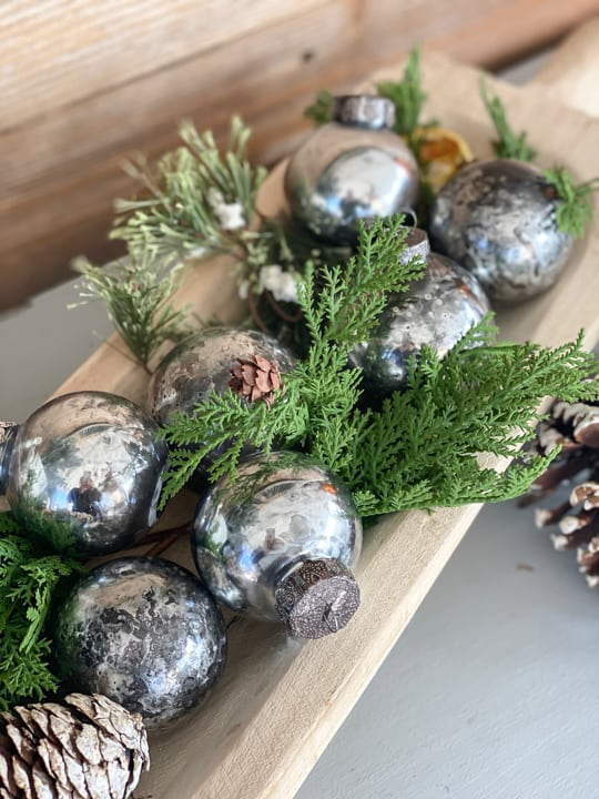 These DIY Mercury Glass Ornaments are easy to make, can be customized to any color you like and they are inexpensive!