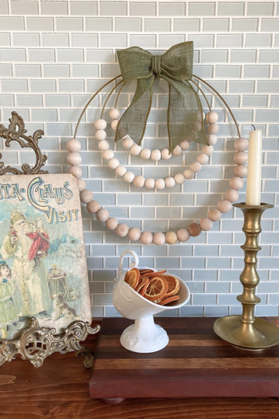 This DIY wood bead wreath is easy to make with only a few supplies and can be customized to match the style of your holiday decor.