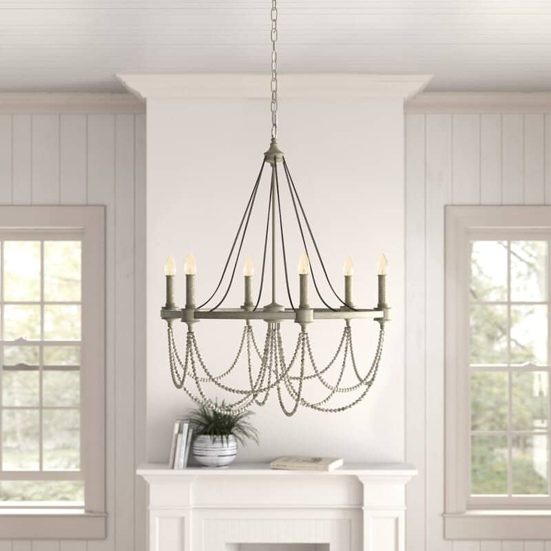 Wood bead chandeliers are so beautiful and they come in all shapes and sizes. This post will give you so many beautiful wood bead chandelier options for any space in your home.