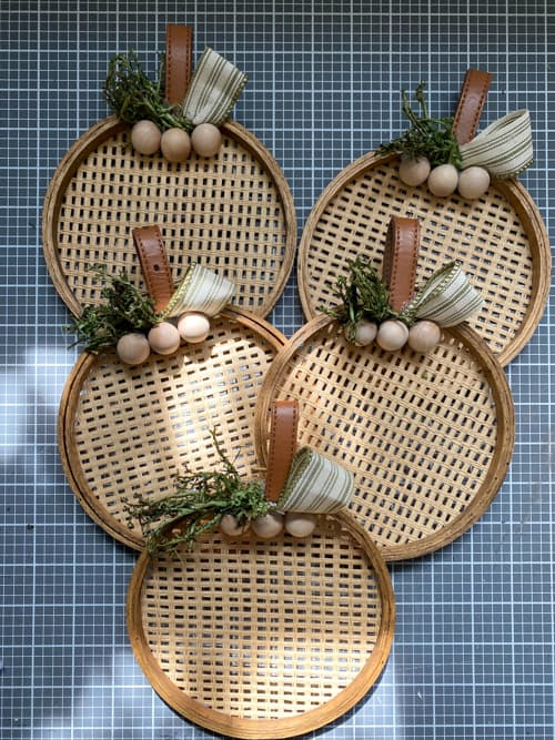 These DIY mini pumpkin wreaths are easy to make and you can customize them to fit the style and look that fits your home this fall!